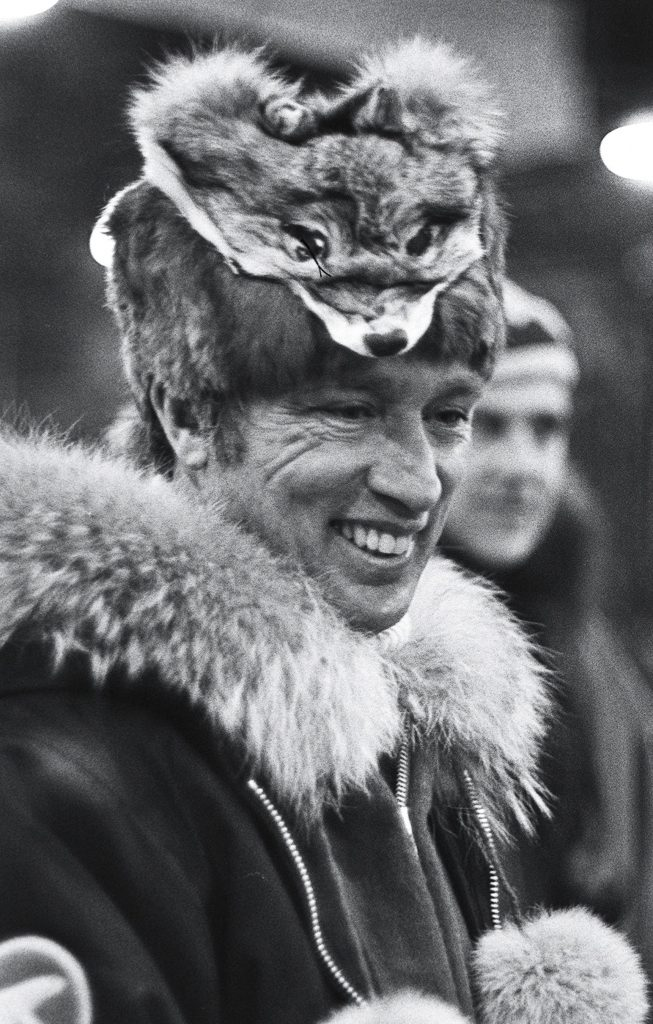 Prime MInister Pierre Trudeau in parka and Muskrat hat topped with the head of a Wolverine lands in Ottawa following a six-day tour of the North West Territories. (CP PHOTO/ Peter Bregg)