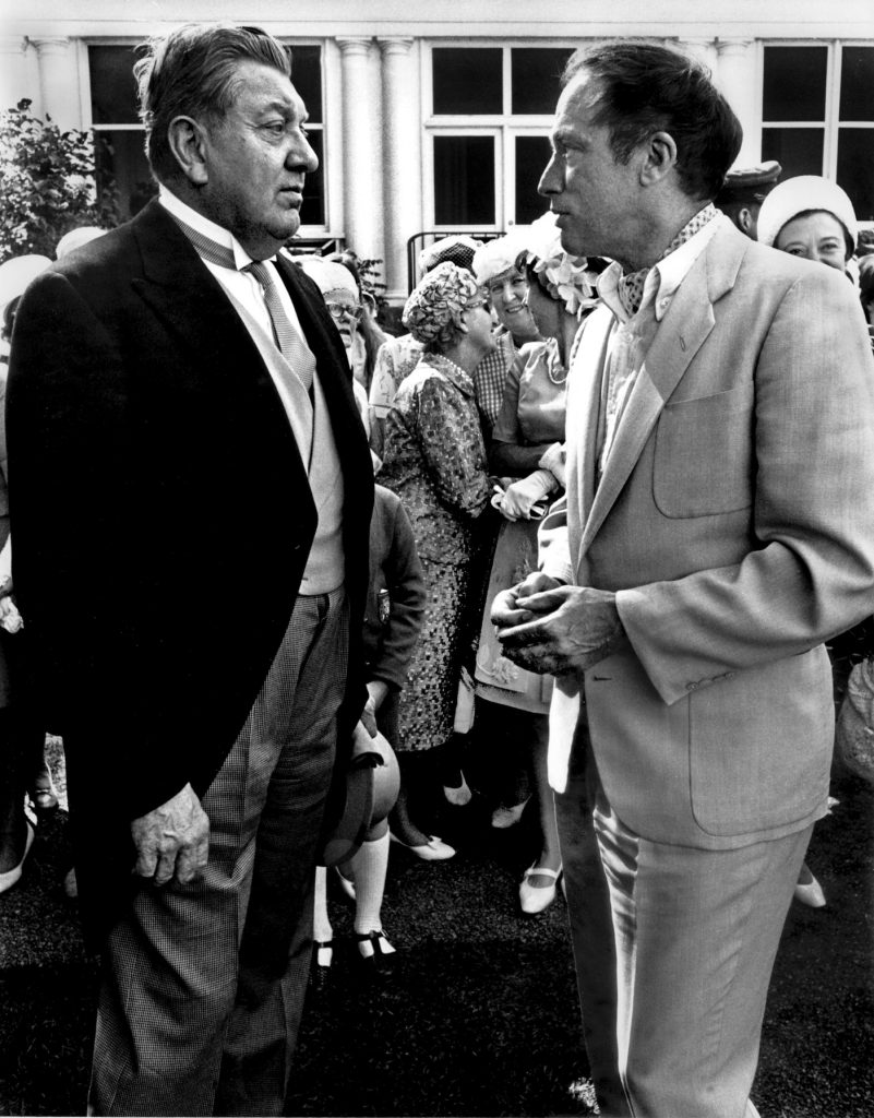 U.S. Ambassador W. Walton Butterworth (1903Ð1975) chats with Prime Minister Pierre Trudeau at the Governor General's garden party in Ottawa July 1968. Butterworth wore the traditional garb for such events at Rideau Hall for the VIP enclosure. Trudeau having been just elected Prime Minister a month earlier appeared in ascot and tan silk suit. The formal attire gave way to more comfortable clothes in subsequent years at the annual garden party. Butterworth was a career diplomat with a forty-year series of diplomatic posts. THE CANADIAN PRESS/ Peter Bregg