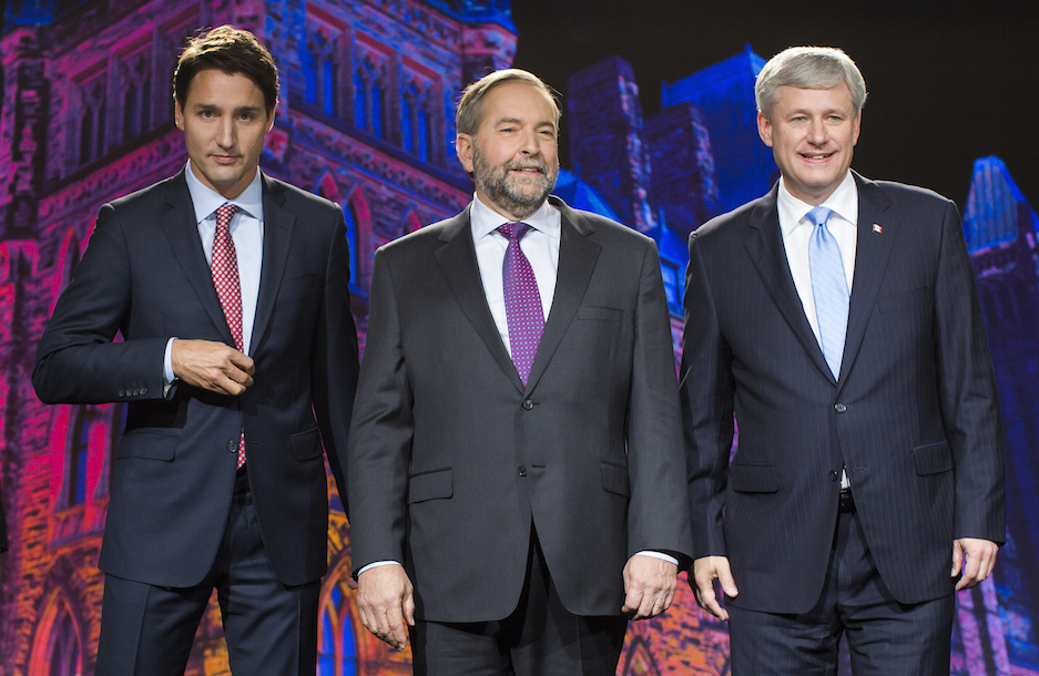 """Justin Trudeau, leader of the Liberal Party of Canada, from left, Thomas """"Tom"""" Mulcair, leader of the New Democratic Party, and Conservative Leader Stephen Harper, Canada's prime minister, stand for a photograph prior to the second leaders' debate in Calgary, Alberta, Canada, on Thursday, Sept. 17, 2015. The debate pits Harper and his Conservative Party's program of tax cuts and spending restraint against the Liberal Party's Trudeau who is pledging to raise taxes on the highest earners and Mulcair of the New Democratic Party who advocates increasing levies on corporations. Photographer: Ben Nelms/Bloomberg via Getty Images"""