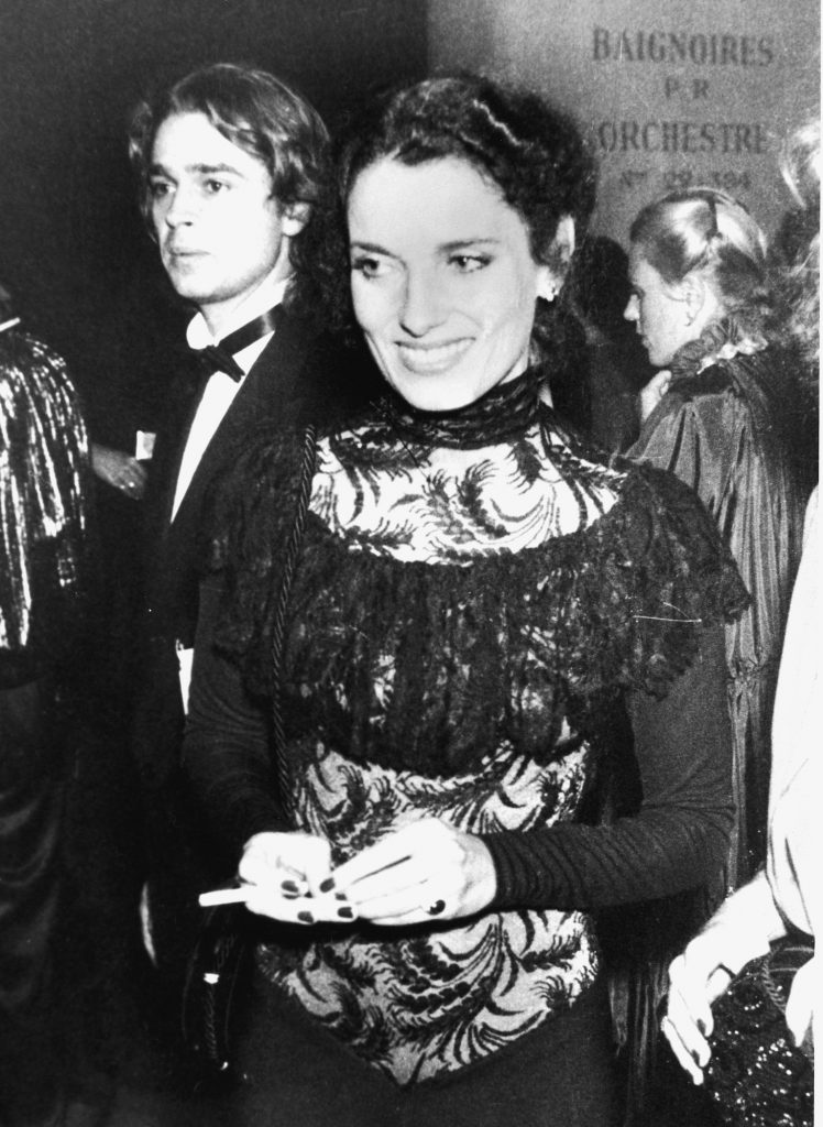 Former First Lady of Canada Margaret Trudeau, estranged wife of Pierre Trudeau, smiles and holds a cigarette at the gala opening of the International Festival of Dance and Theatre at the Champs-Elysees, Paris, France, October 19, 1978. An unidentifed man in a tuxedo stands near her. (Photo by Pictorial Parade/Getty Images)