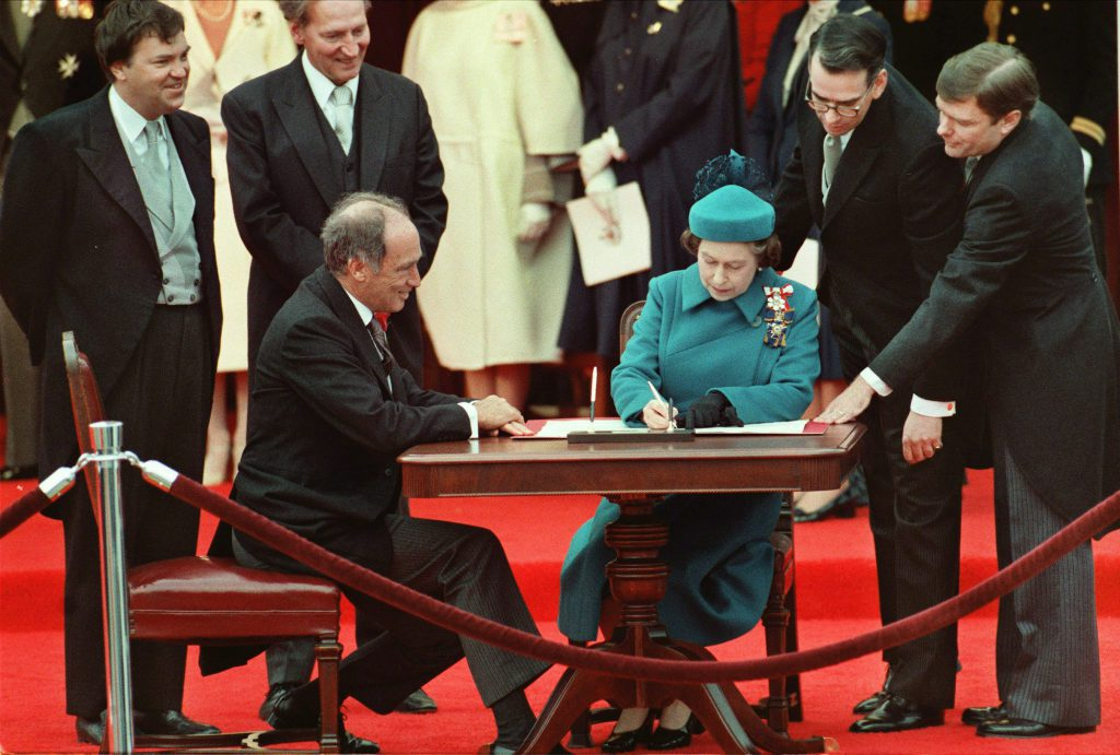 Queen Elizabeth II signs Canada's constitutional proclamation in Ottawa on April 17, 1982 as Prime Minister Pierre Trudeau looks on. The Harper government says it will mark the 30th anniversary of the patriation of the Constitution — by issuing a couple of news releases.THE CANADIAN PRESS/Stf-Ron Poling