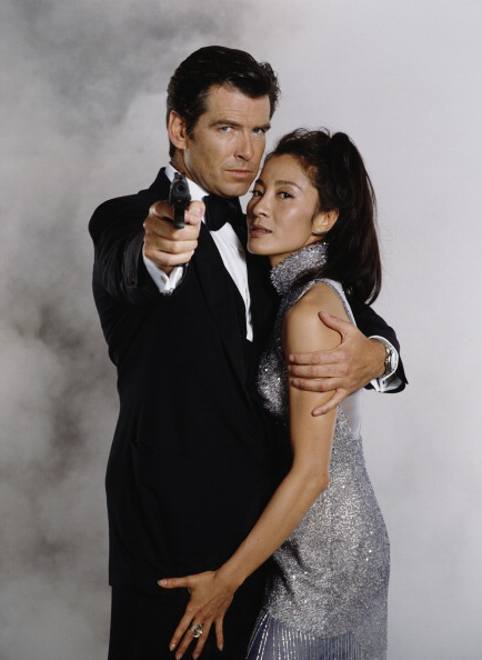 Irish actor Pierce Brosnan stars as 007 opposite Malaysian actress Michelle Yeoh in the James Bond film 'Tomorrow Never Dies' 1997. He is holding a Walther P99 semi-automatic pistol. (Photo by Keith Hamshere/Getty Images)