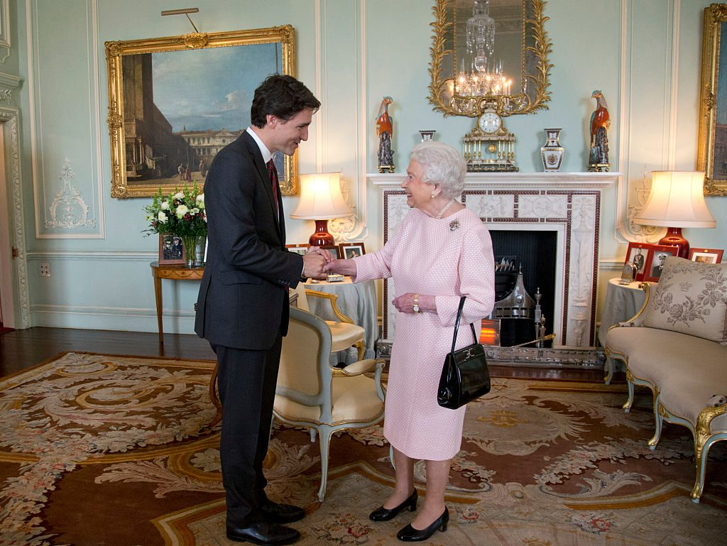 LONDON, UNITED KINGDOM - NOVEMBER 25: Prime Minister of Canada Justin Trudeau shake hands with Queen Elizabeth II during a private audience at Buckingham Palace on November 25, 2015 in London, England. This is the first visit of Trudeau in Britain since his election as Canadas Prime Minister. (Photo by Yui Mok - WPA Pool/Getty Images)
