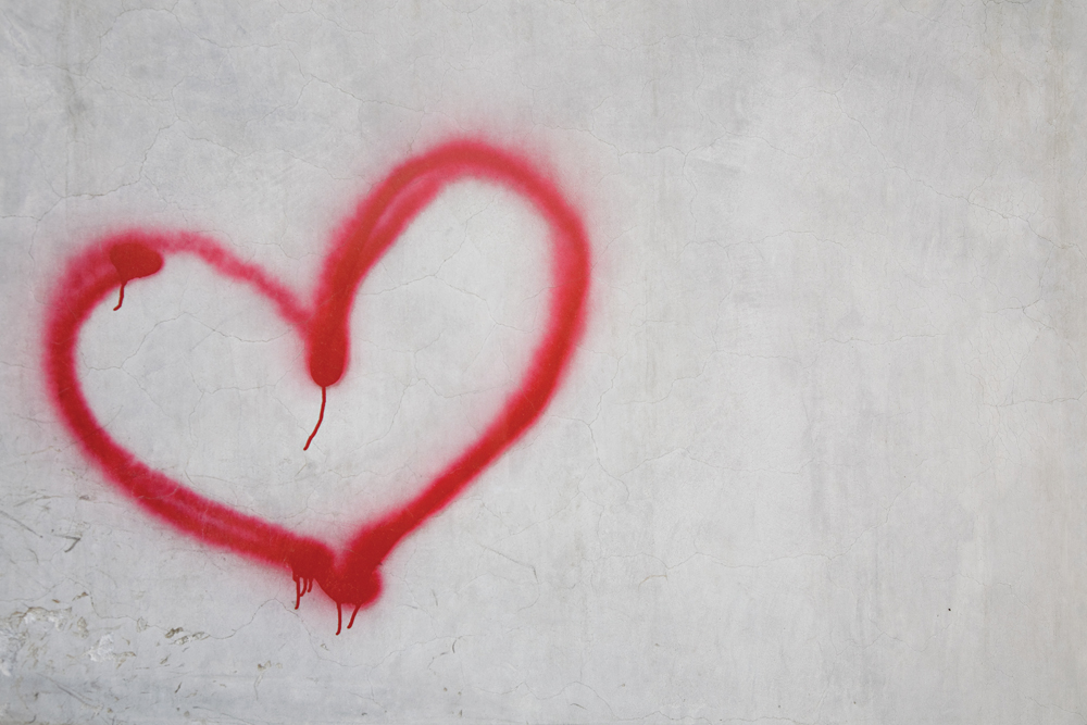 Red heart shape on white wall