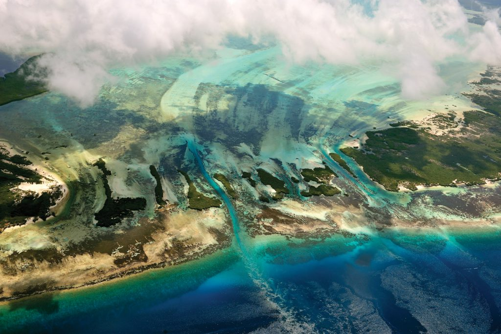 Aerial view of islands, coral and tidal channels at the coast, Aldabra, Seychelles