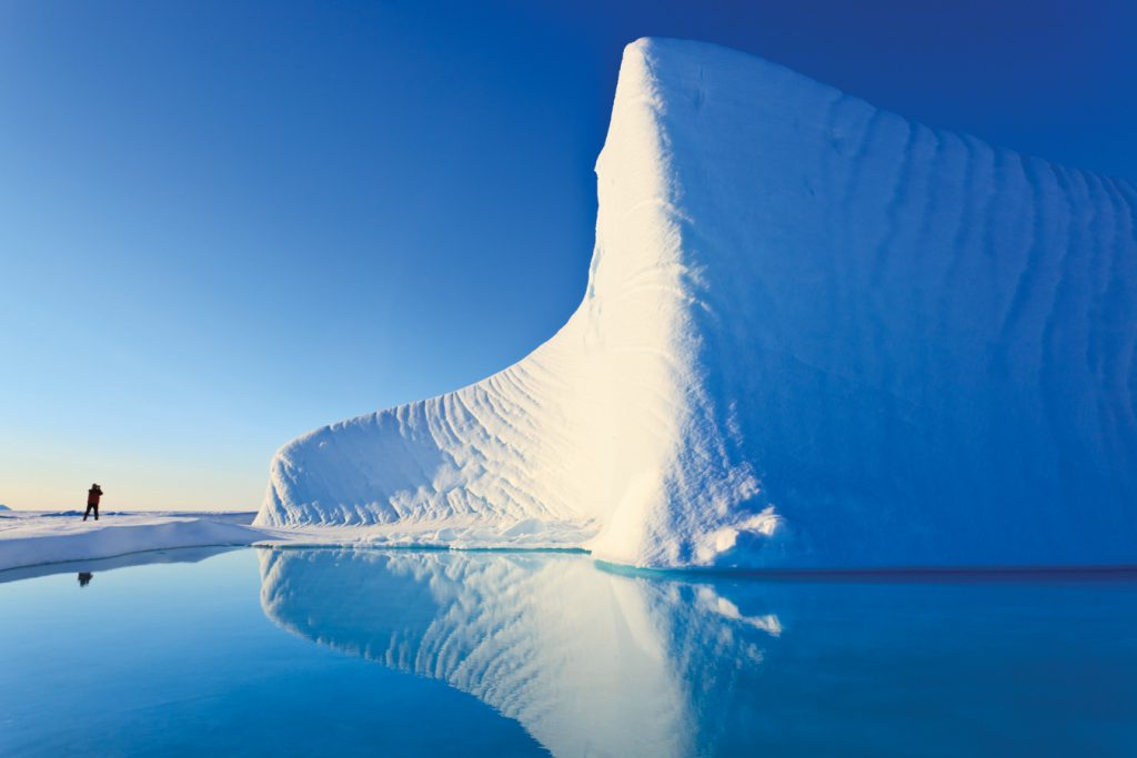 Photographing an iceberg in Baffin Bay on the Arctic Ocean, north of Baffin Island, Nunavut, Canada in the Canadian Arctic