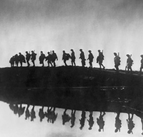 5th October 1917: Supporting troops of the 1st Australian Division walking on a duckboard track near Hooge, in the Ypres Sector. They form a silhouette against the sky as they pass towards the front line to relieve their comrades, whose attack the day before won Broodseinde Ridge and deepened the Australian advance. (Photo by Frank Hurley/Hulton Archive/Getty Images)