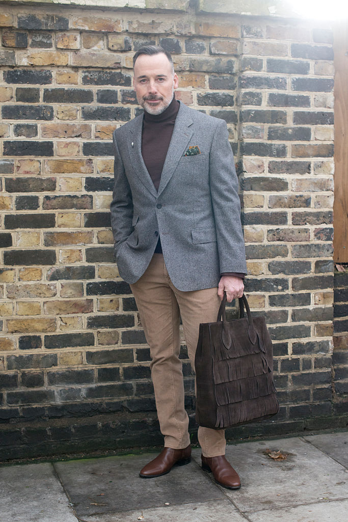LONDON, ENGLAND - JANUARY 11: Film director David Furnish wears a Kingsman jacket, Drake's pocket square and Burberry bag on day 4 of London Collections: Men on Januay 11, 2016 in London, England. (Photo by Kirstin Sinclair/Getty Images)*** Local Caption *** David Furnish