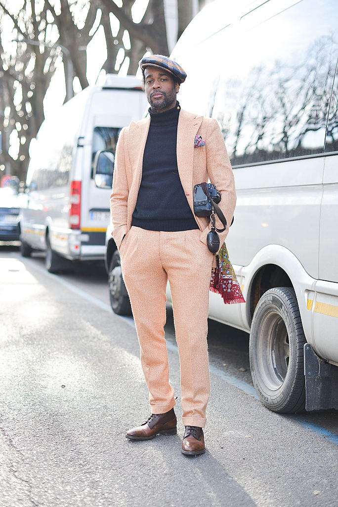 MILAN, ITALY - JANUARY 18: Photographer Karl-Edwin Guerre poses wearing a Leonardi Suit, Borsalino hat and Ralph Laurent sweater before the Emporio Armani show during the Milan Men's Fashion Week Fall/Winter 2016/17 on January 18, 2016 in Milan, Italy. (Photo by Vanni Bassetti/Getty Images)