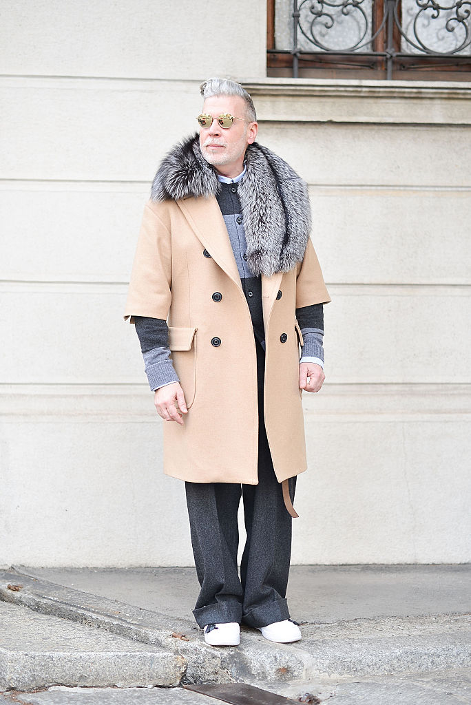 MILAN, ITALY - JANUARY 18: Nick Wooster poses wearing a Nick Wooster X Lardini coat before the Etro show during the Milan Men's Fashion Week Fall/Winter 2016/17 on January 18, 2016 in Milan, Italy. (Photo by Vanni Bassetti/Getty Images)