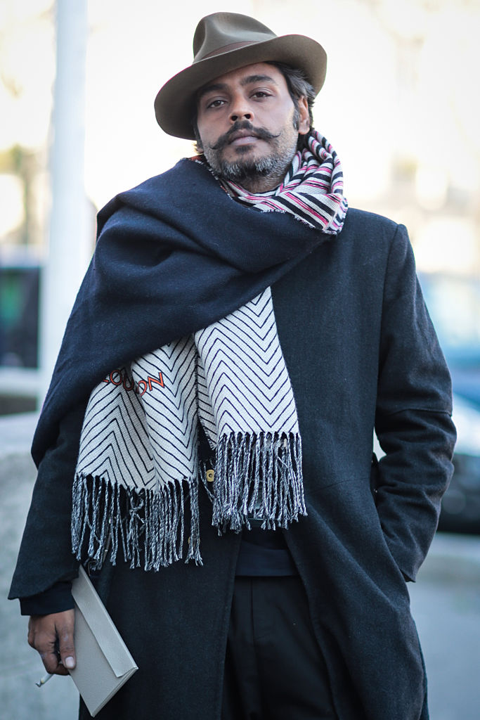 PARIS, FRANCE - JANUARY 21: GQ Fashion Director Vijendra Bhardwaj wearing a Louis Vuitton scarf, Gaurav Gupta coat and pants, Prada shoes and a Borsalino hat after the Rick Owens show during Paris Fashion Week Menswear Fall Winter 2016/2017 on January 21, 2016 in Paris, France. (Photo by Edward Berthelot/Getty Images)