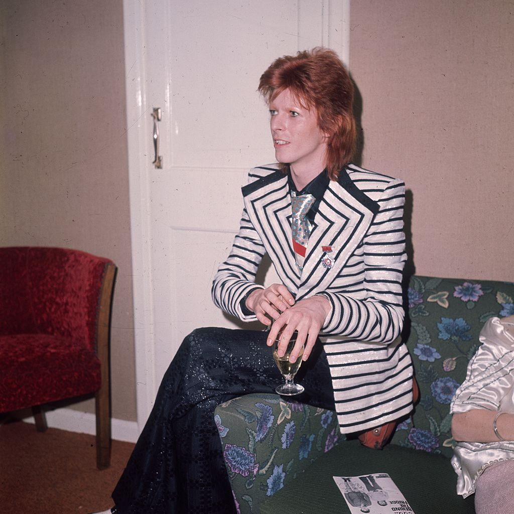 May 1973: In a black and white horizontally striped jacket with wide lapels glam rock star David Bowie. (Photo by Hulton Archive/Getty Images)