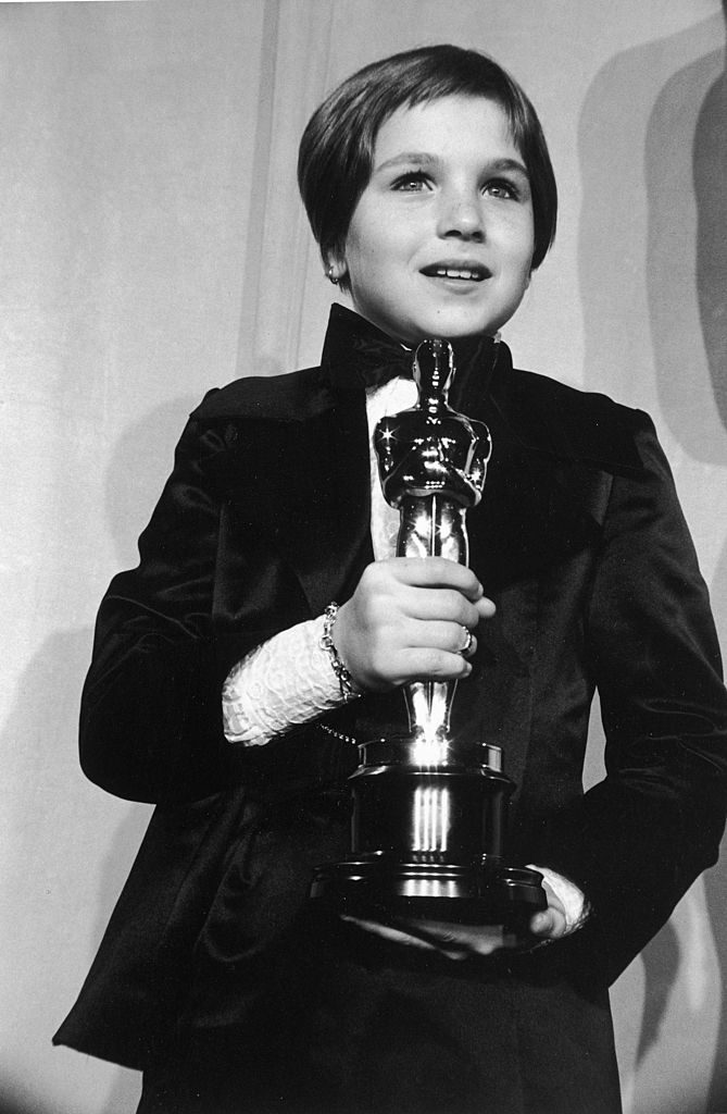 2nd April 1974: American actor Tatum O'Neal, wearing a tuxedo, holds her Oscar for Best Supporting Actress for her role in director Peter Bogdanovich's film, 'Paper Moon,' at the 46th Annual Academy Awards, Dorothy Chandler Pavilion, Los Angeles, California. She was the youngest actor to ever win an Oscar. (Photo by Hulton Archive/Getty Images)