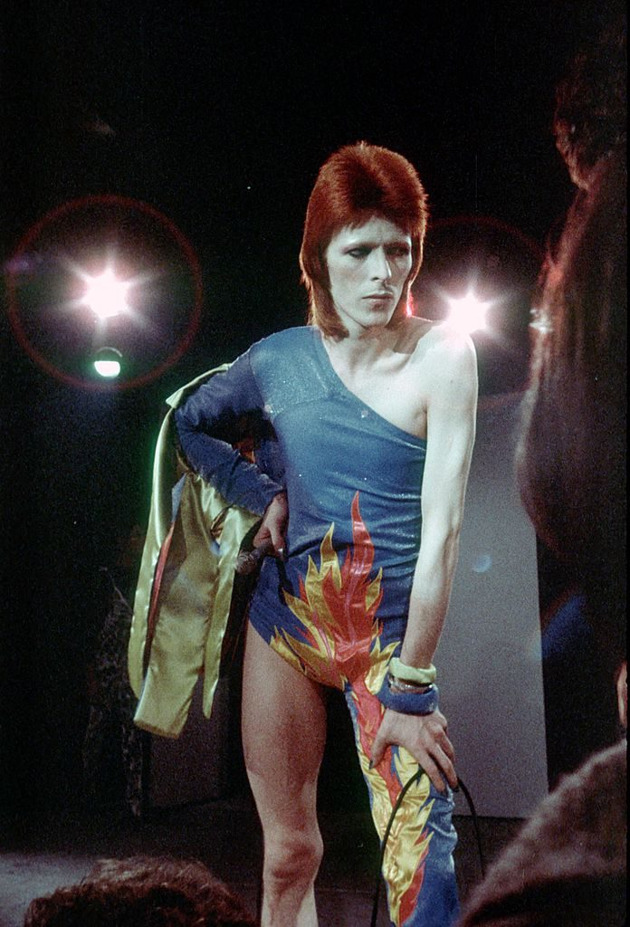"""1973: Musician David Bowie performs onstage during his """"Ziggy Stardust"""" era in 1973. (Photo by Michael Ochs Archives/Getty Images)"""
