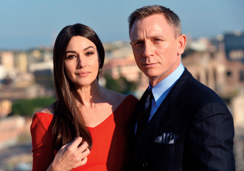 Italian actress Monica Bellucci and British actor Daniel Craig pose during a photocall to promote the 24th James Bond film 'Spectre' on February 18, 2015 at Rome's city hall. AFP PHOTO / TIZIANA FABI (Photo credit should read TIZIANA FABI/AFP/Getty Images)