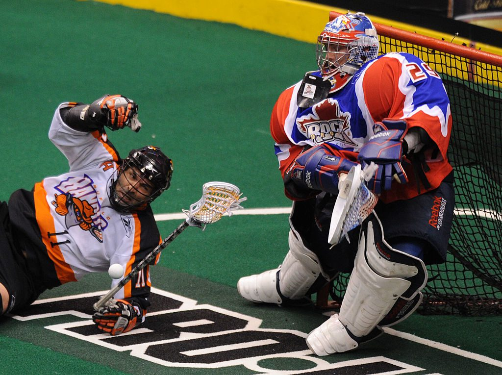 May 1, 2010 -John Tavares of the Buffalo Bandits tries to get a shot on Bob Watson of the Toronto Rock during their Lacrosse playoff game at the ACC. The Toronto Rock defeated the Buffalo Bandits 13-11. (Photo by Carlos Osorio/Toronto Star via Getty Images)