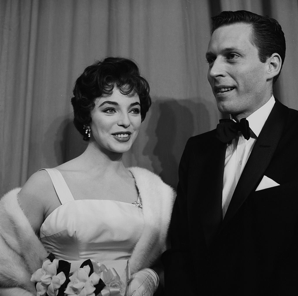 LOS ANGELES, CA - MARCH 21,1956: Joan Collins with a guest at the Academy Awards in Los Angeles, California. (Photo by Earl Leaf/Michael Ochs Archives/Getty Images)
