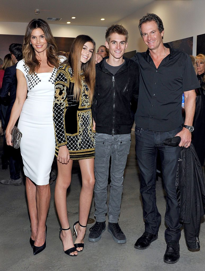 """WEST HOLLYWOOD, CA - DECEMBER 04: (L-R) Cindy Crawford, model Kaia Jordan Gerber, Presley Walker Gerber, and businessman Rande Gerber attend a book party in honor of """"Becoming"""" by Cindy Crawford, hosted by Bill Guthy And Greg Renker, at Eric Buterbaugh Floral on December 4, 2015 in West Hollywood, California. (Photo by Donato Sardella/WireImage)"""