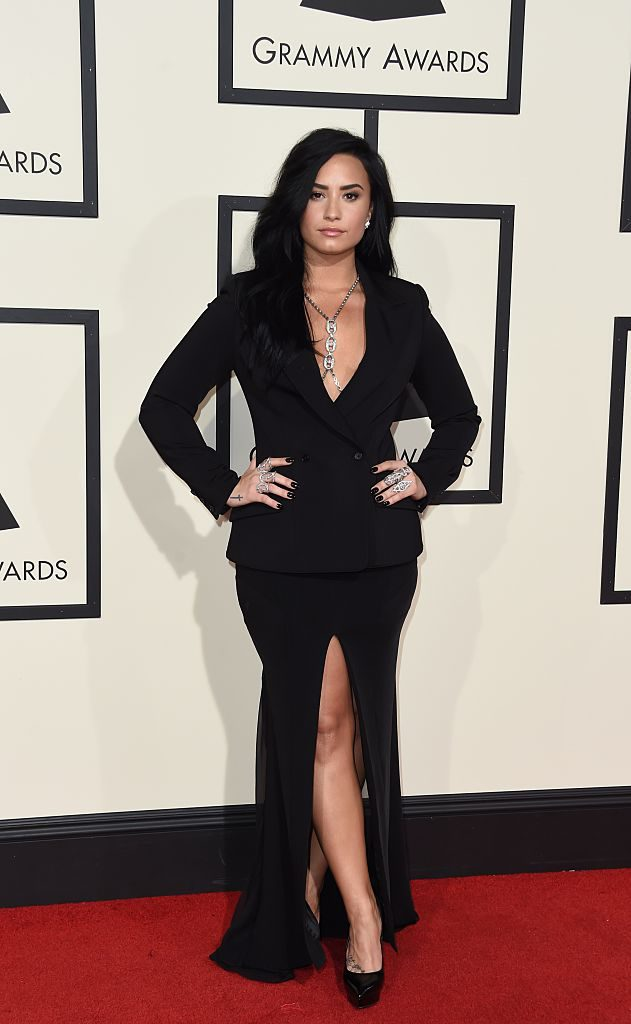 Demi Lovato arrives on the red carpet for the 58th Annual Grammy music Awards in Los Angeles February 15, 2016. AFP PHOTO/ VALERIE MACON / AFP / VALERIE MACON (Photo credit should read VALERIE MACON/AFP/Getty Images)
