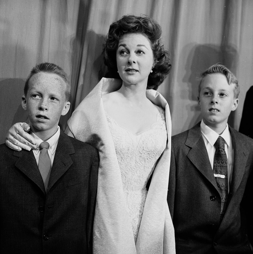 LOS ANGELES - MARCH 21, 1956: Actress Susan Hayward with sons Gregory and Tim attends the Academy Awards in Los Angeles, California. (Photo by Earl Leaf/Michael Ochs Archives/Getty Images)