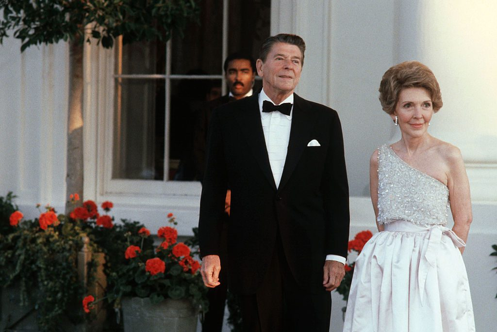 WASHINGTON - UNDATED: (NO U.S. TABLOID SALES) U.S. President Ronald Reagan and wife Nancy wait for the arrival of a Head-of-State guest at the North Portico of the White House in Washington, DC in this undated photo. (Photo by David Hume Kennerly/Getty Images)