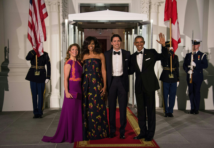 US President Barack Obama (R), Canadian Prime Minister Justin Trudeau (2nd R) and their wives Michelle Obama (2nd L) and Sophie Gregoire Trudeau (L) pose u[pon the Trudeau's arrival for a State Dinner in their honor at the White House in Washington, DC, on March 10, 2016. / AFP / Nicholas Kamm (Photo credit should read NICHOLAS KAMM/AFP/Getty Images)