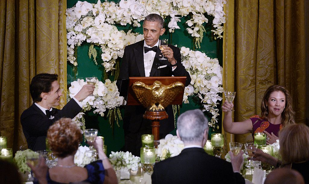 WASHINGTON, DC - MARCH 10: President Barack Obama (C) gives a toast as Prime Minister Justin Trudeau (L) and First Lady Sophie Trudeau of Canada look on during a State Dinner at the White House March 10, 2016 in Washington, D.C. (Photo by Olivier Douliery-Pool/Getty Images)