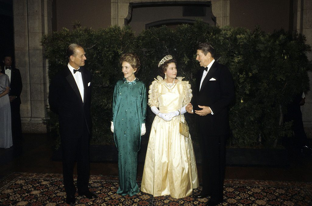SAN FRANCISCO - MARCH 5: Queen Elizabeth ll, wearing a much critisized dress with bows and frills, Prince Philip, Duke of Edinburgh, President Ronald Reagan and his wife Nancy Reagan attend a banquet on March 5, 1983 in San Francisco, California. (Photo by Anwar Hussein/Getty Images)