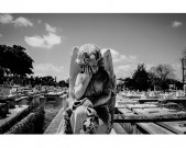 Statue of Angel Crying In Cemetery