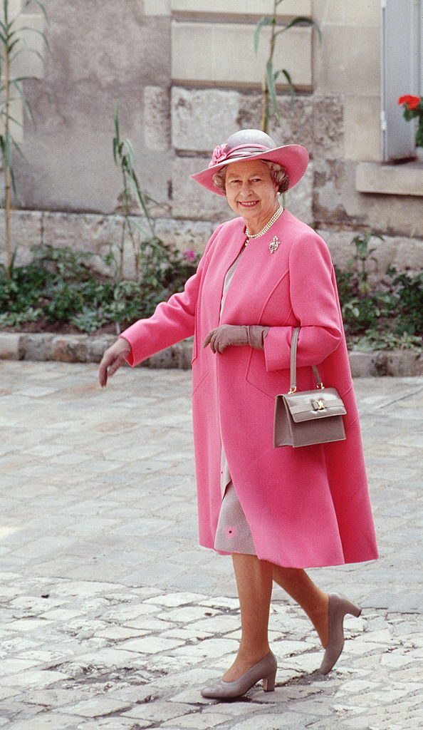 BLOIS, FRANCE - JUNE 11: The Queen On A Visit To Blois In France Wearing A Pink And Taupe Outfit Designed By Fashion Designer Ian Thomas With Colour Co-ordinated Taupe Shoes And Accessories (Photo by Tim Graham/Getty Images)