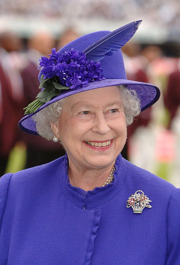 LONDON - MAY 17: (NO PUBLICATION IN UK MEDIA FOR 28 DAYS) Queen Elizabeth ll smiles as she is presented to the English and West Indian cricket teams during the first N-Power Test Match at Lords on May 17, 2007 in London, England. (Photo by Pool/Anwar Hussein Collection/Getty Images)