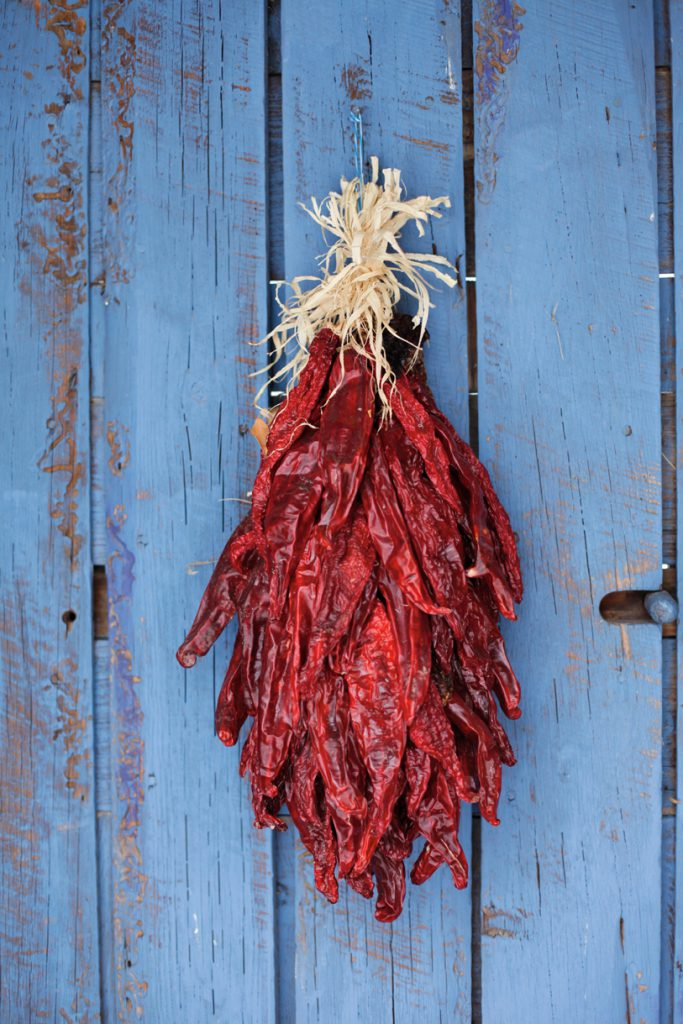 Traditional chili ristra hangs on door, Santa Fe, New Mexico, USA