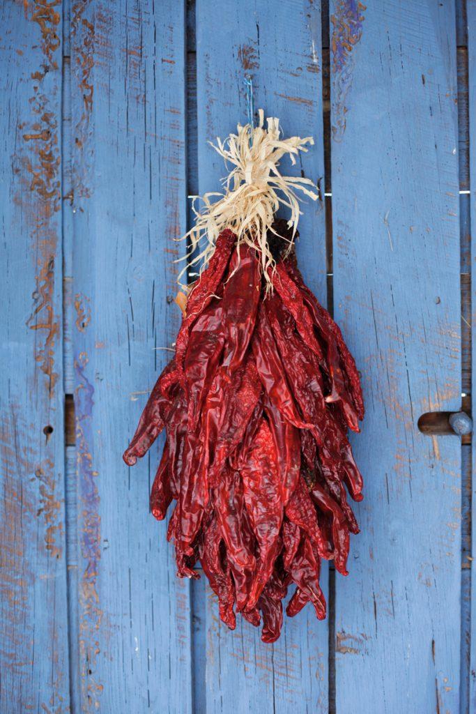 Traditional chili ristra hangs on door, Santa Fe, New Mexico, USA