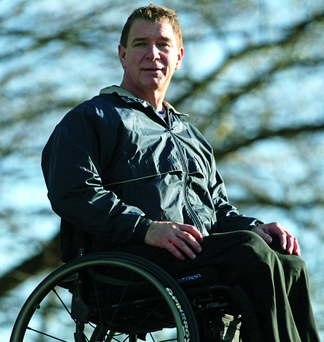 """It has been exactly 25 years since Canada's """"Man in Motion,"""" Rick Hansen, completed his round-the-world tour to raise funds for spinal cord research. Hansen poses for a photograph outside his foundation's offices in Richmond, B.C., on Sunday January 30, 2011. THE CANADIAN PRESS/Darryl Dyck"""