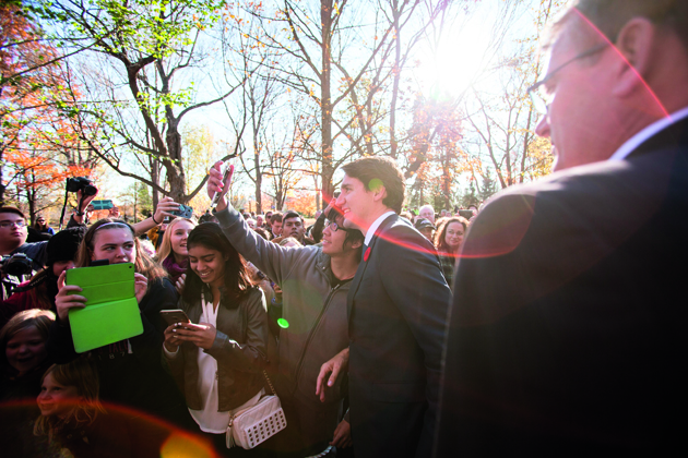 Canadian Prime Minister Justin Trudeau takes a selfie as he greets the crowd outside Rideau Hall after being sworn in as Canada's 23rd Prime Minister in Ottawa, Ontario, November 4, 2015. AFP PHOTO/ GEOFF ROBINS (Photo credit should read GEOFF ROBINS/AFP/Getty Images)