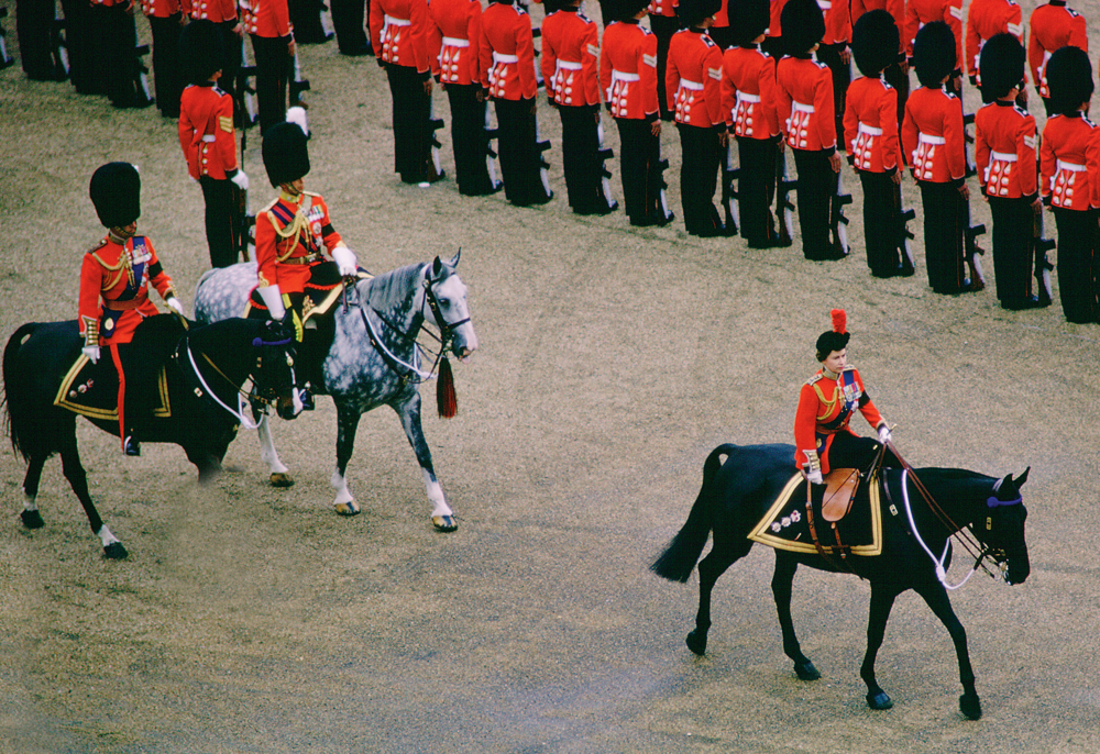 LONDON, UNITED KINGDOM - JUNE 03: Queen Elizabeth II On Horseguards Parade In London Riding Her Horse 'burmese' During The Traditional Queen's Birthday Parade At Trooping The Colour Ceremony. In Her Hat Is The Red Plume Of The Household Division The Coldstream Guards Whose Turn It Is To Have Their Colour Trooped. The Black Armbands Are Court Mourning After The Death Of The Duke Of Windsor. (Photo by Tim Graham/Getty Images)
