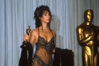"""049920 01: Actress Cher holds her Oscar at the Academy Awards April 11, 1988 in Los Angeles, CA. Cher won the 1988 Best Actress Oscar for her role as Loretta Castorini in """"Moonstruck."""" (Photo by Marc Biggins/Liaison)"""