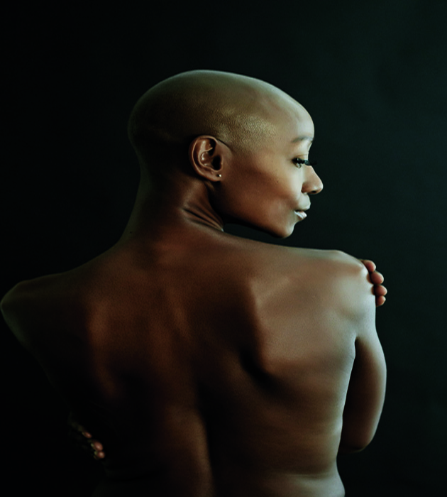 29 Oct 2014 --- Nude African American woman looking over her shoulder --- Image by � Blend Images/Corbis