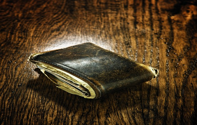 Still life of worn out wallet