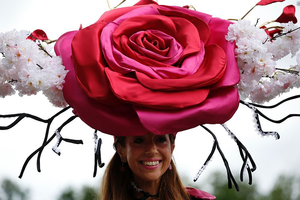 A racegoer poses for a picture during Ladies day at Royal Ascot in Ascot, west of London on June 16, 2016. The five-day meeting is one of the highlights of the horse racing calendar. Horse racing has been held at the famous Berkshire course since 1711 and tradition is a hallmark of the meeting. Top hats and tails remain compulsory in parts of the course while a daily procession of horse-drawn carriages brings the Queen to the course. / AFP / ADRIAN DENNIS (Photo credit should read ADRIAN DENNIS/AFP/Getty Images)
