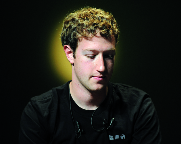 "Mark Zuckerberg, chief executive officer and founder of Facebook Inc., pauses at the Cannes Lions International Advertising Festival in Cannes, France, on Wednesday, June 23, 2010. Facebook Inc., the world's most popular social-networking site, is ""pretty close"" to announcing a deal with a geographic-location service, Zuckerberg said. Photographer: Antoine Antoniol/Bloomberg via Getty Images"