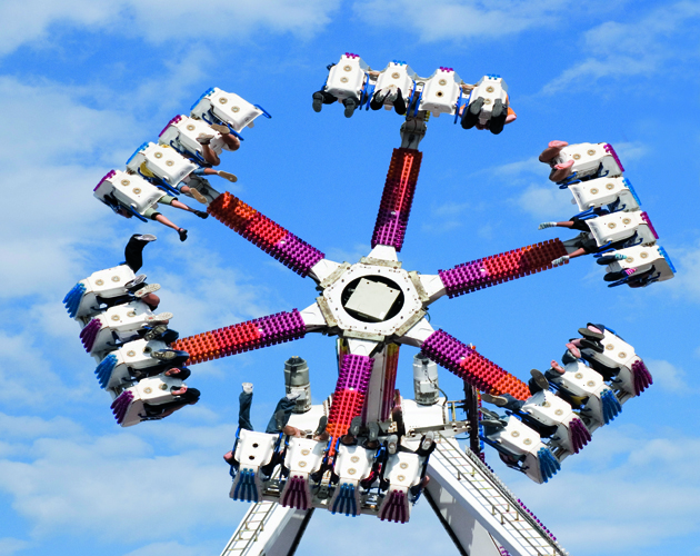 """""""Ground view of midway spinning ride in Toronto, Canadian National Exhibition.More thrills:"""""""