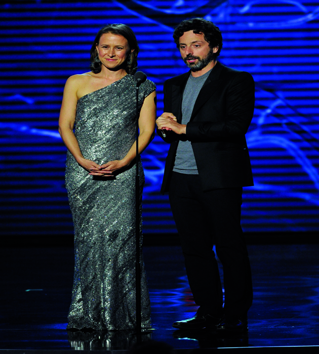 MOUNTAIN VIEW, CA - NOVEMBER 09: Breakthrough Prize Founders Anne Wojcicki (L) and Sergey Brin speak onstage during the Breakthrough Prize Awards Ceremony Hosted By Seth MacFarlane at NASA Ames Research Center on November 9, 2014 in Mountain View, California. (Photo by Steve Jennings/Getty Images for Breakthrough Prize)