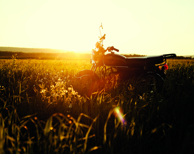 Motorcycle parked in rural field