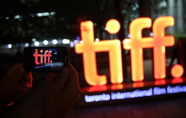 TIFF goers take pictures of TIFF sign