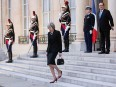 Francois Hollande, France's president, stands while Theresa May, U.K. Prime Minister, leaves the Elysee Palace in Paris, France, on Thursday, July 21, 2016. Hollande told May that Britain faces a choice: Accept unlimited immigration from the European Union or lose access to its single market. Photographer: Christophe Morin/Bloomberg via Getty Images