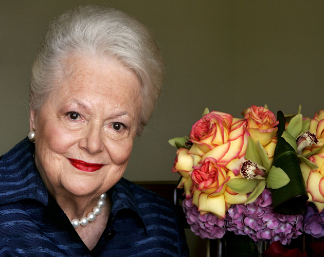 "FILE - In this Wednesday, Sept. 15, 2004, file photo, actress Olivia de Havilland, who played the doomed Southern belle Melanie in ""Gone With the Wind,"" poses for a photograph in Los Angeles. In rare public remarks about her sister and fellow Oscar-winning actress, Olivia de Havilland mourned the loss of Joan Fontaine, with whom de Havilland reportedly feuded for much of their lives on Monday, Dec. 16, 2013. (AP Photo/Kevork Djansezian, File)"