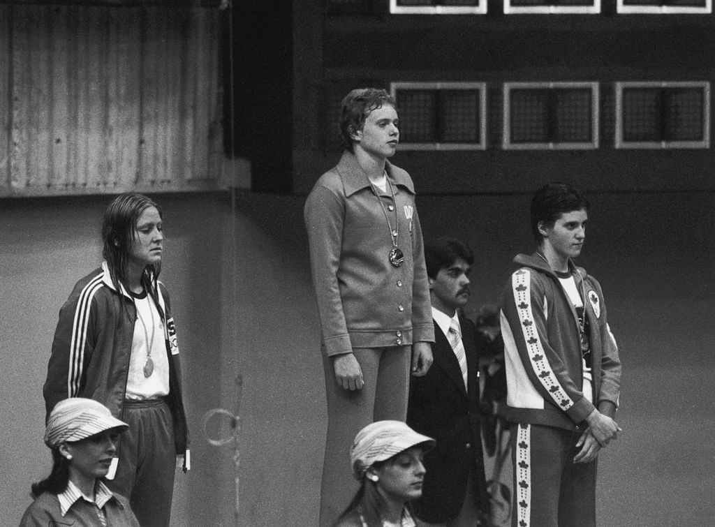 Swimmers recieve their medals after the women's 400 metres freestyle event at the Montreal Olympics, July 1976. Left to right: Shirley Babashoff of the U.S.A. (bronze), Petra Thumer of East Germany (gold) and Shannon Smith of Canada (silver). (Photo by Keystone/Hulton Archive/Getty Images)
