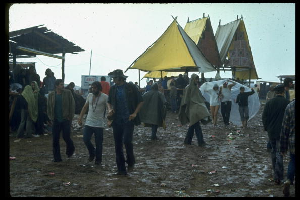 NEW YORK, UNITED STATES - AUGUST 1969: Overall of crowds of young people milling around big yellow tents during the Woodstock Music & Art Fair. (Photo by John Dominis/The LIFE Picture Collection/Getty Images)