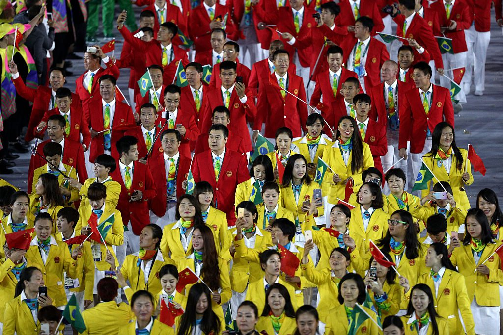 RIO DE JANEIRO, BRAZIL - AUGUST 05: Members of the China Olympic team takes part in the Opening Ceremony of the Rio 2016 Olympic Games at Maracana Stadium on August 5, 2016 in Rio de Janeiro, Brazil. (Photo by Paul Gilham/Getty Images)